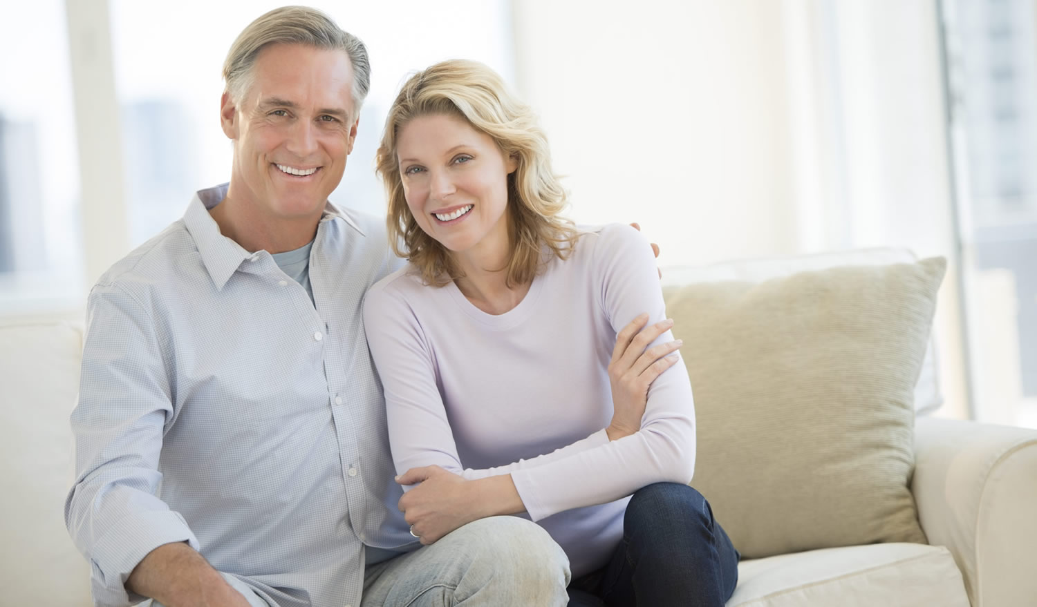 Happy mature couple relaxing in their livingroom, London City Mortgages
